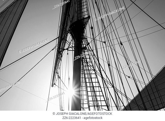The Star of India's mast and rigging against the setting Sun. San Diego, California, United States