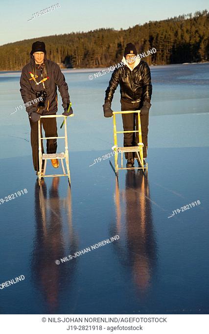Brothers kicksledding Northern Sweden