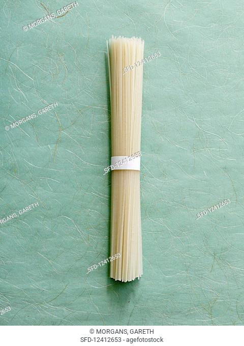 A bundle of rice noodles on a textured background