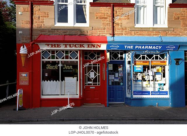 Scotland, Angus, Edzell, Exterior of a brightly painted tuck shop and pharmacy