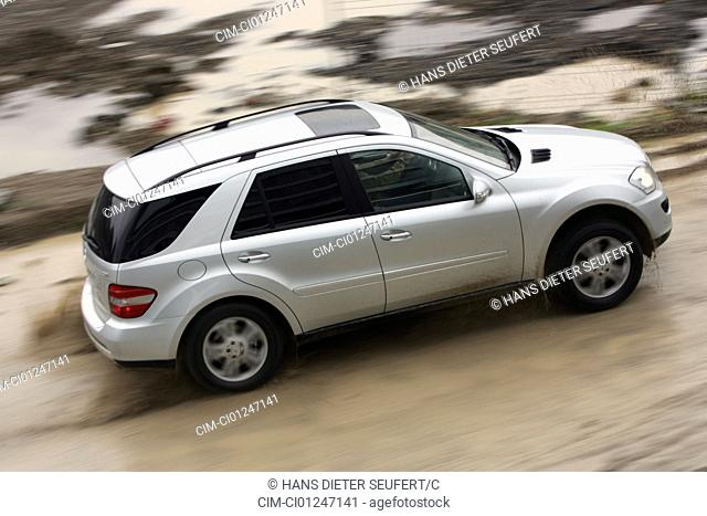 Car, Mercedes ML 320 CDI, model year 2005-, silver, cross country vehicle, driving, diagonal from the back, rear view, side view, offroad, Mud, Water