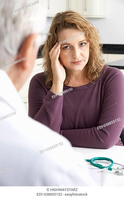 Worried Plus Size Woman Meeting With Doctor In Surgery