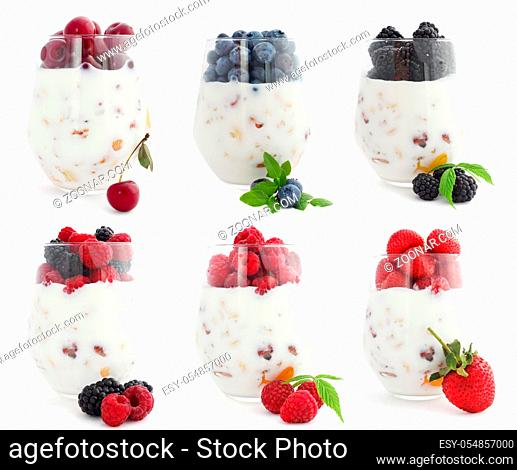 Healthy and useful colorful berry cokctalis, smoothies and milkshakes with yogurt, fresh fruit berries cereals and nuts studio isolated on white background