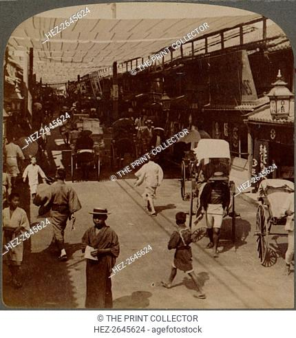 'Mid-summer traffic under awnings of Shiro-bashidori, a busy thoroughfare of Kyoto, Japan', 1904. Artist: Unknown