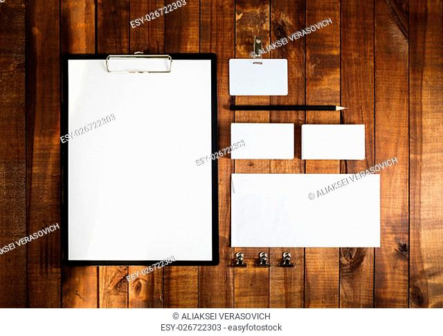 Blank business brand template on wooden table background. Blank stationery set on wooden table background. Letterhead, business cards, badge