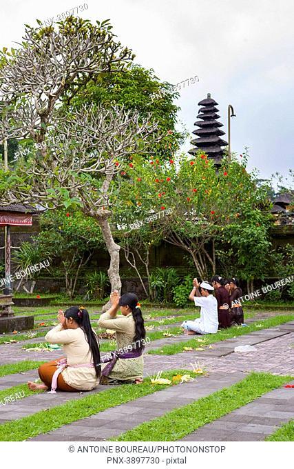 Women praying during the Hindu Kuningan ceremony at Besakih Temple in Bali, Indonesia