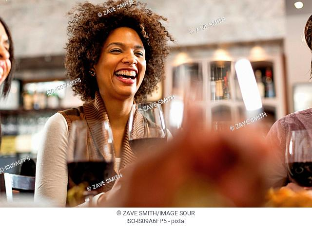 Woman at restaurant laughing