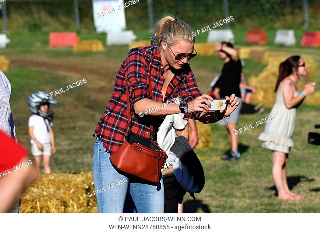 Model, race-car driver, and television personality Jodie Kidd attends 12-hour lawn mower marathon as the official race starter Featuring: Jodie Kidd Where: Five...