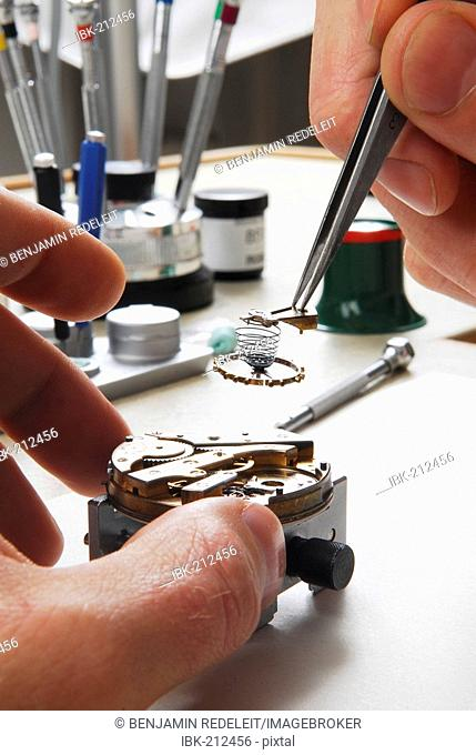 Watchmaker cleaning a pocket watch
