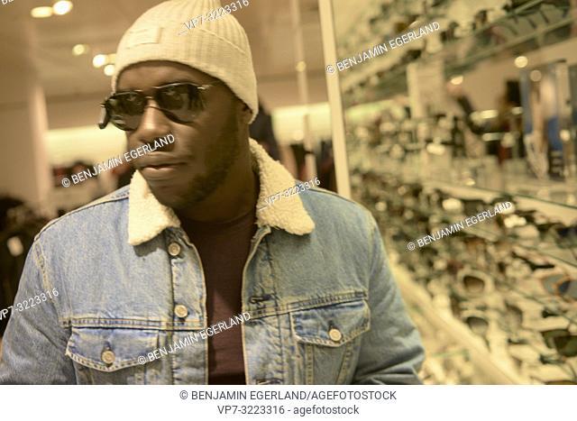man wearing sunglasses in sunglasses store