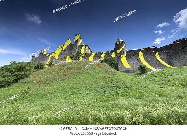 To celebrate the 20 years of its classification at UNESCO, The French town of Carcassonne couvered the walls of itâ. . s medieval city with circles of yellow...