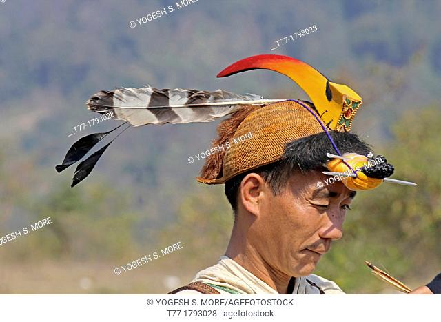 Nyishi tribe, man perform Traditional Bow & Arrow Competition at Namdapha Eco Cultural Festival, Miao, Arunachal Pradesh, India