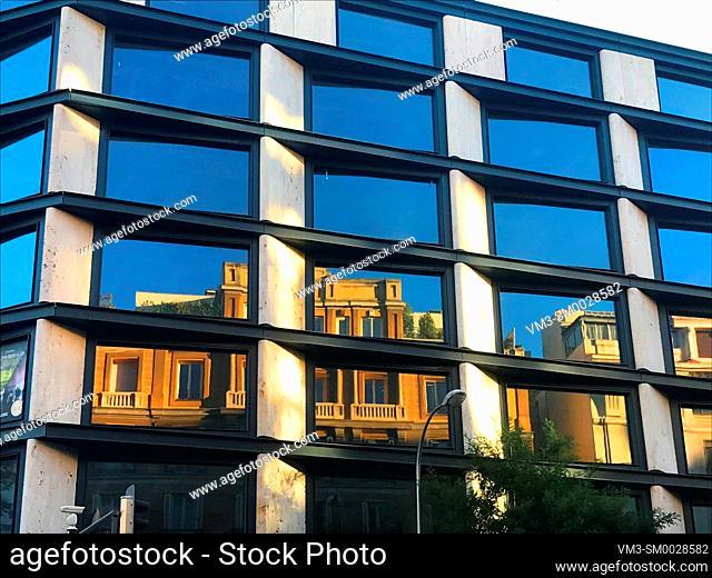 Reflections on facade of modern building. Goya street, Madrid, Spain