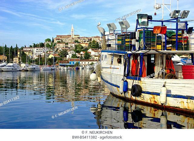fishing trawler in harbour, old town of Vrsar in background, Croatia, Istria, Vrsar
