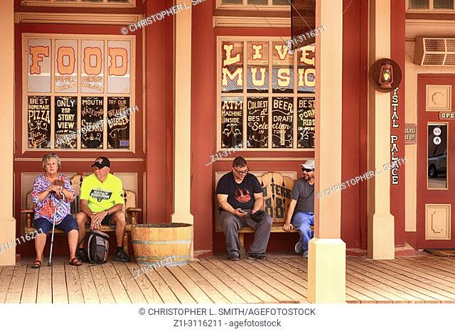 People outside Crystal Palace Saloon on E Allen St in historic Tombstone, Arizona