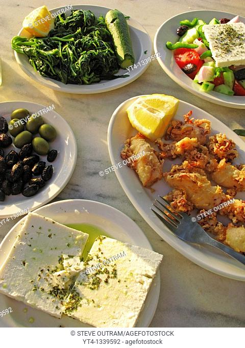 Greek Cuisine  Feta, Kalamari, Olives, Salad and Vleeta Stamnagathi Wild Greens
