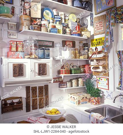KITCHEN - Wood vacation home. Many antiques, collectibles, old advertising boxes and tins, wood butter molds, partial sink open shelves