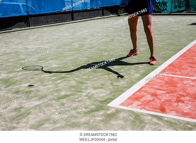 Close-up of female tennis player on court