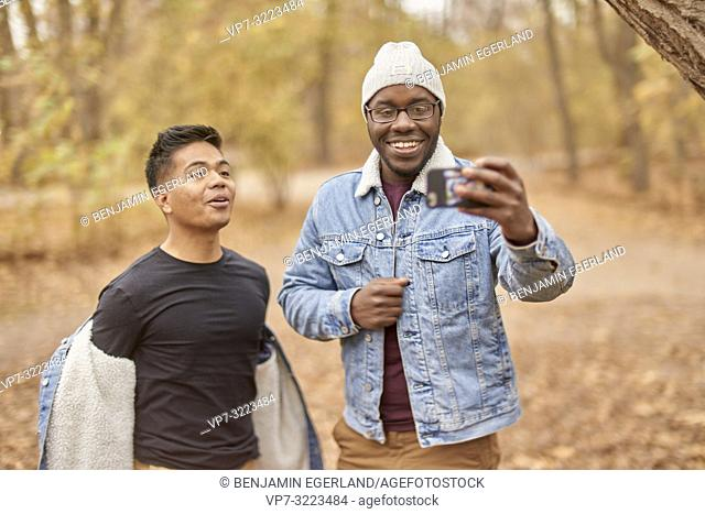 friends taking selfie, nature, in park Englischer Garten, in Munich, Germany