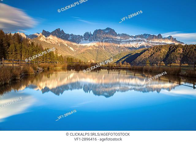 Europe, Italy, Valley of Tiersertal, South Tyrol, Alto Adige, Dolomites. Reflections of Catinaccio - Rosengarten at sunset on the lake Wuhn