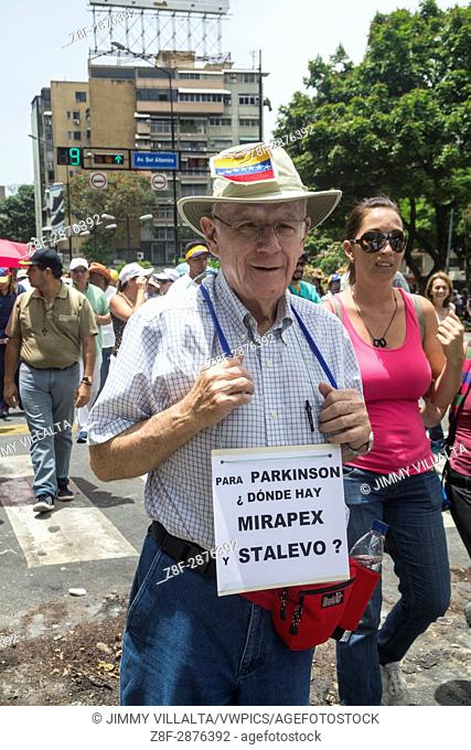 """A man shows a sign that says: For Parkinson's where there is Mirapex and Stalevo. The opposition mobilization called """"""""Great March for Health and Life"""""""" was..."""
