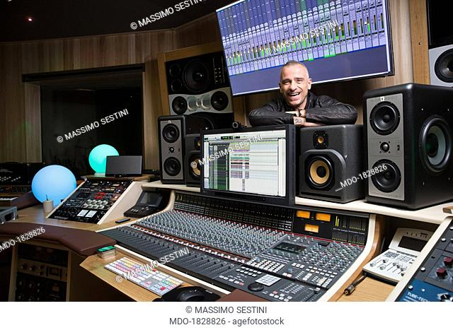 The singer Eros Ramazzotti leaning on a sound mixer in a photo shooting shooted at his own recording studio L'Isola. Milan, Italy. 22nd October 2012