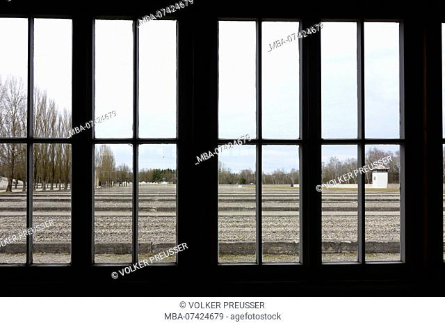 Dachau, concentration camp, view through window of prisoner barrack to other 32 barracks that are indicated by concrete foundations, Upper Bavaria, Bavaria