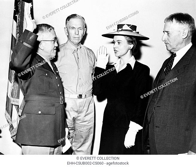 Oveta Culp Hobby, Director of Women's Auxiliary Army Auxiliary Corps, takes oath. May 16, 1942. L-R: Maj. Gen. Myron C. Kramer; Army Chief of Staff George...