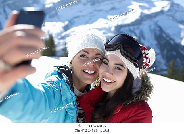 Friends taking selfie in snow