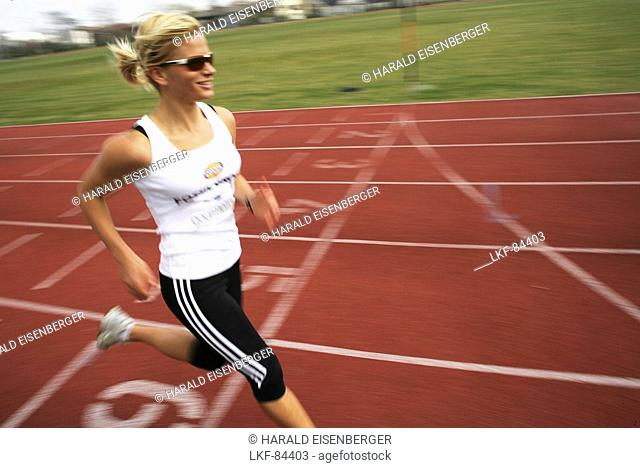 Woman runner on cinder track, Carinthia, Austria