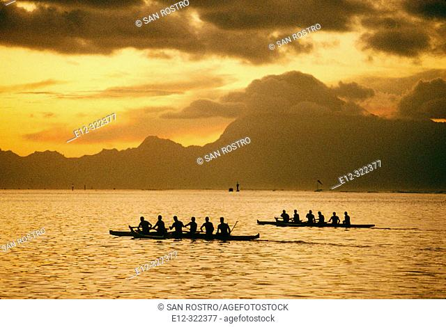 Training for the annual rowing contest, Moorea island in background. Papeete, Tahiti, French Polynesia