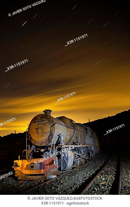 Old steam locomotive on a starry night