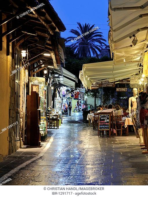 Street, Odos Agisandrou with shops and tavernas, Rhodes Town, Rhodes, Greece, Europe