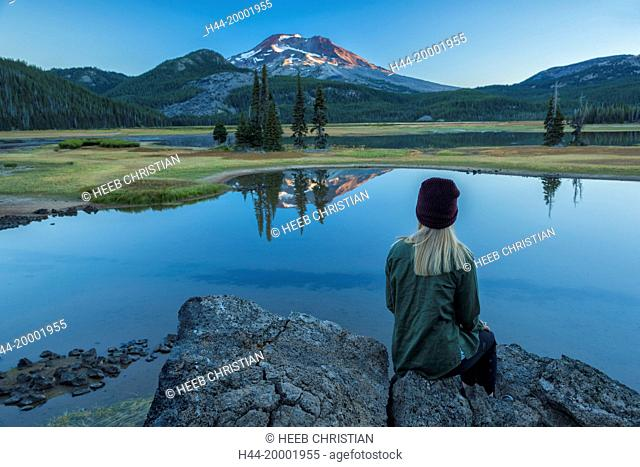 Girl sitting at Sparks Lake at sunrise, MR