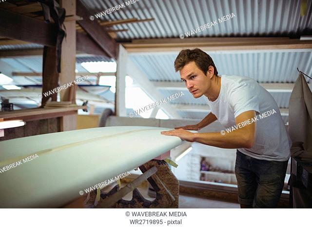 Man making surfboard