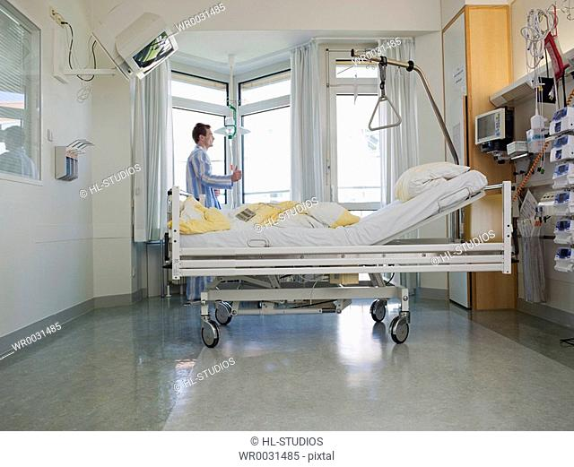 Patient in hospital ward