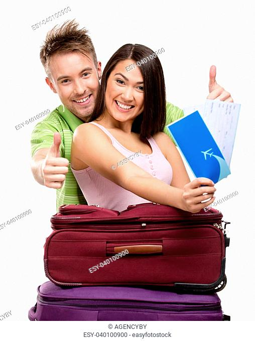 Couple with suitcases and tickets, isolated on white background. Concept of romantic vacations and lovely honeymoon