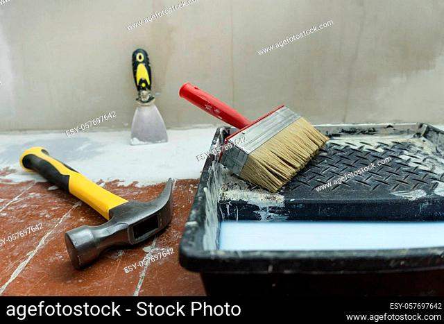 Construction and painting tools lie on the floor during the repair and restoration of the house.Work as a Builder or handyman in the house