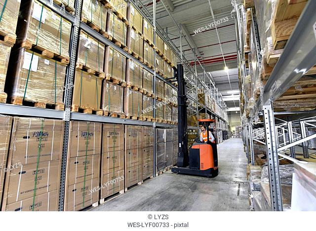 Man in factory hall on forklift