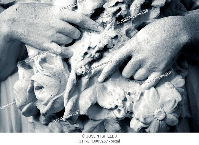 Detail showing the hands of a sculpture in Bonaventure Cemetery