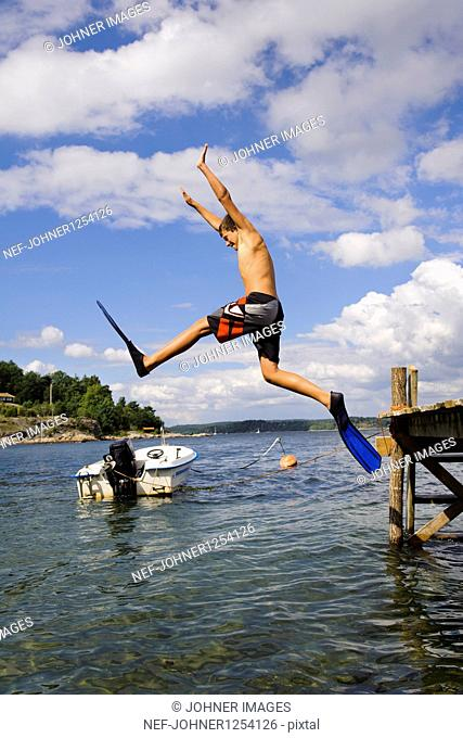 A boy jumping into the water