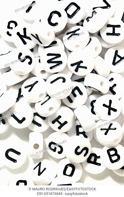 Plastic beads with letters isolated on a white background