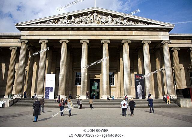 The Greek Revival facade of the entrance to the British Museum on Great Russell Street by Sir Robert Smirke. It features 44 columns based on the temple of...