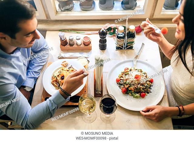Couple having dinner in a restaurant, top view