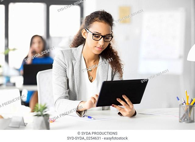 businesswoman with tablet pc working at office