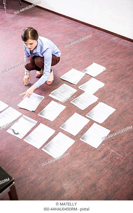 Business people organizing papers