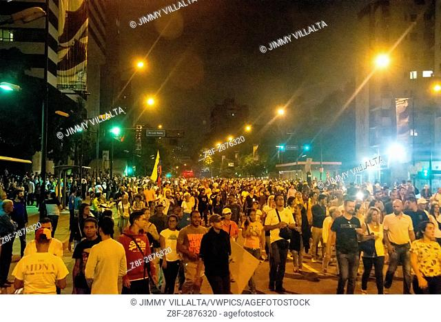 Thousands of demonstrators walk on Francisco de Miranda Avenue, in the march of lights. Thousands of opponents of the Venezuelan government, Nicolas Maduro
