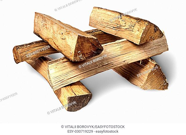 Pile of firewood stacked at each other isolated on white background