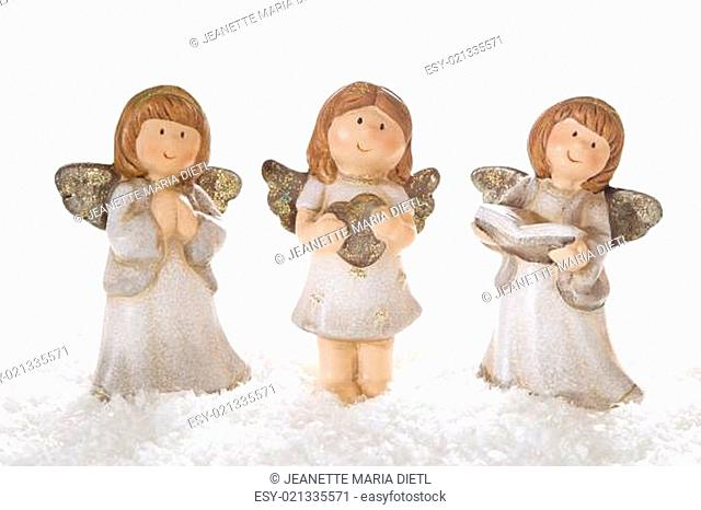 Three christmas angels in white isolated for decoration