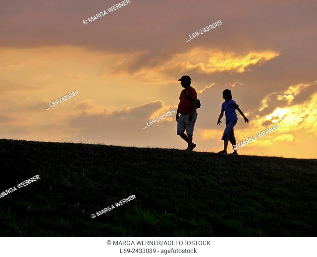 People walking on a dyke, island Neuwerk, Elbe estuary, North Sea, Hamburg, Germany